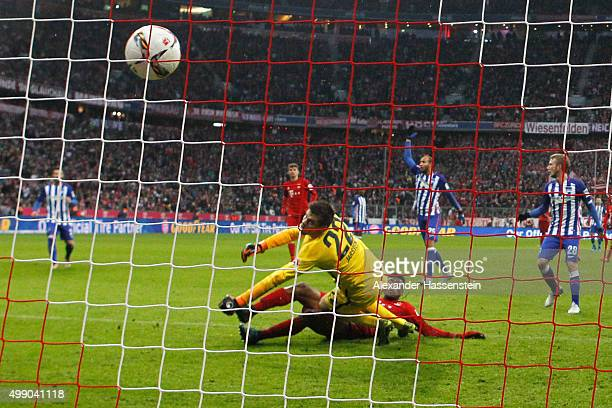 Kingsley Coman of Muenchen scres the second team goal against Rune Jarstein keeper of Berlin during the Bundesliga match between FC Bayern Muenchen...