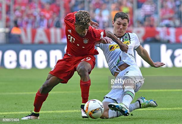 Kingsley Coman of Munich and Andreas Christensen of Moenchengladbach fight for the ball during the Bundesliga soccer match between Bayern Munich and...