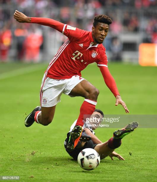 Kingsley Coman of Munich and Aymen Barkok of Frankfurt vie for the ball during the Bundesliga soccer match between FC Bayern Munich and Eintracht...