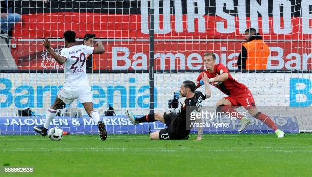 Kingsley Coman of Munich in action against Roberto Hilbert and Bernd Leno of Leverkusen during the Bundesliga soccer match between Bayer 04...