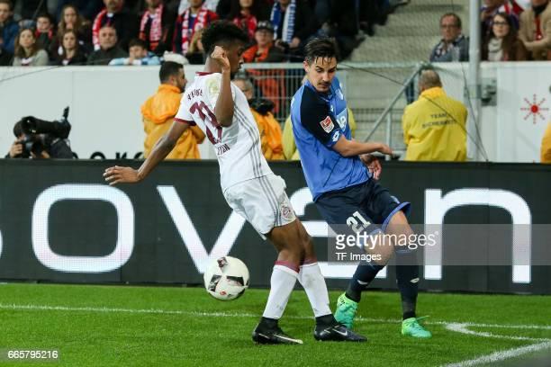 Kingsley Coman of Munich und Benjamin Huebner of Hoffenheim battle for the ball during the Bundesliga match between TSG 1899 Hoffenheim and Bayern...