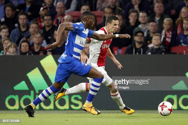 Kingsley Ehizibue of PEC Zwolle Nick Viergever of Ajax during the Dutch Eredivisie match between Ajax Amsterdam and PEC Zwolle at the Amsterdam Arena...