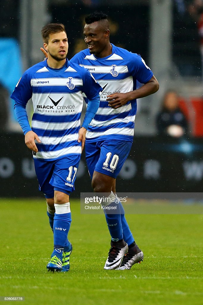 Kingsley Onuegbu of Duisburg (R) celebrates the first goal during the 2. Bundesliga match between MSV Duisburg and Fortuna Duesseldorf at Schauinsland-Reisen-Arena on April 29, 2016 in Duisburg, Germany.