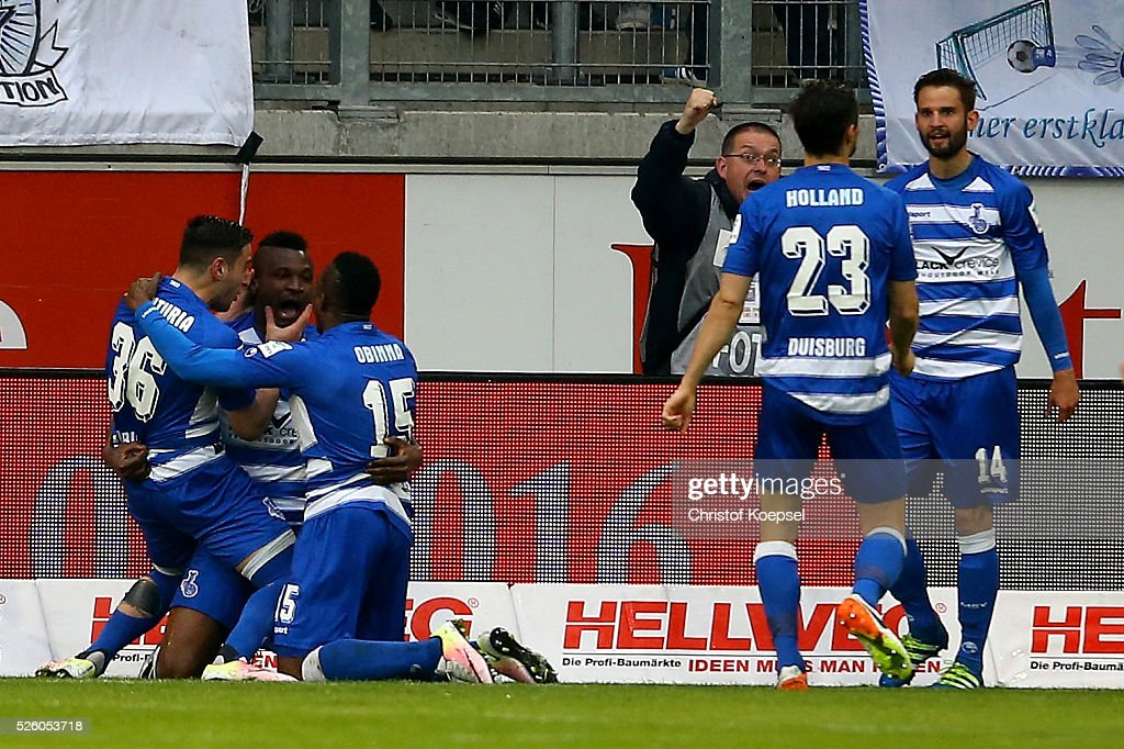 Kingsley Onuegbu (2nd L) of Duisburg celebrates the first goal with Giorigi Chanturia (L) and <a gi-track='captionPersonalityLinkClicked' href=/galleries/search?phrase=Victor+Obinna&family=editorial&specificpeople=2218719 ng-click='$event.stopPropagation()'>Victor Obinna</a> (3rd L) during the 2. Bundesliga match between MSV Duisburg and Fortuna Duesseldorf at Schauinsland-Reisen-Arena on April 29, 2016 in Duisburg, Germany.