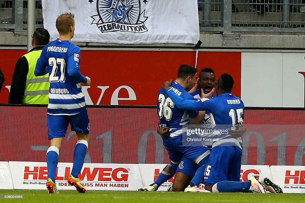Kingsley Onuegbu of Duisburg (2n R) celebrates the first goal with Dan-Patrick Poggenberg (L), Giorigi Chanturia of Duisburg (2nd L) and <a gi-track='captionPersonalityLinkClicked' href=/galleries/search?phrase=Victor+Obinna&family=editorial&specificpeople=2218719 ng-click='$event.stopPropagation()'>Victor Obinna</a> of Duisburg (R) during the 2. Bundesliga match between MSV Duisburg and Fortuna Duesseldorf at Schauinsland-Reisen-Arena on April 29, 2016 in Duisburg, Germany.