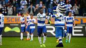 Kingsley Onuegbu of Duisburg celebrates with mascot Ennatz after the Third League match between MSV Duisbrug and Preussen Muenster at...
