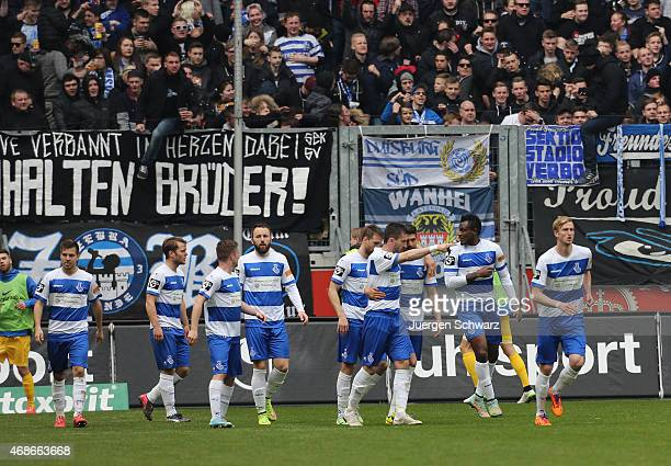 Kingsley Onuegbu of Duisburg celebrates with teammates after scoring during the 3rd Bundesliga match between MSV Duisburg and Hansa Rostock at...