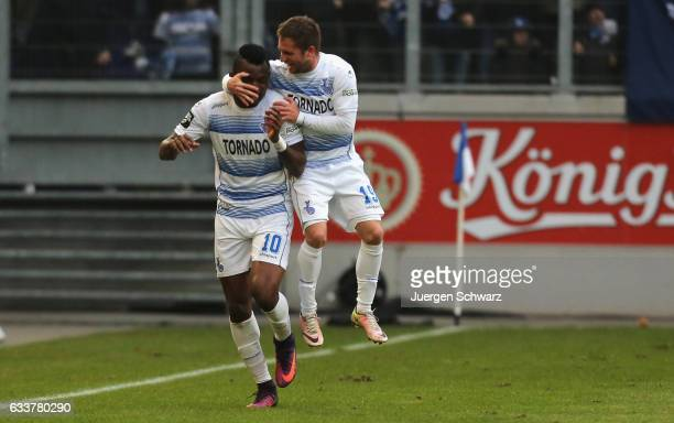 Kingsley Onuegbu of Duisburg is hugged by Nico Klotz after scoring the second goal during the third league match between MSV Duisburg and VfL...