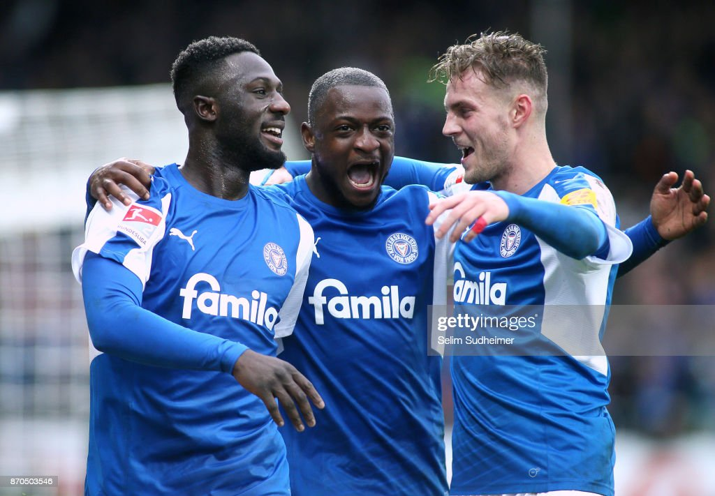 Kingsley Schindler, David Kinsombi and Marvin Ducksch of Holstein Kiel celebrate their teams third goal scoring during the Second Bundesliga match between Holstein Kiel and SG Dynamo Dresden at Holstein-Stadion on November 5, 2017 in Kiel, Germany.