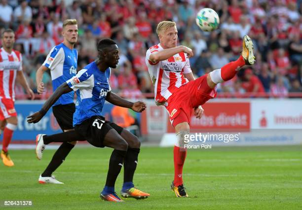 Kingsley Schindler of Kieler SV Holstein and Kristian Pedersen of 1 FC Union Berlin during the game between Union Berlin and Kieler SV Holstein on...