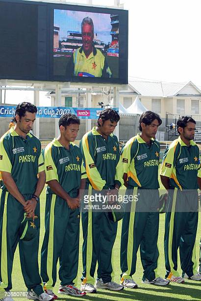 A picture of late Pakistani cricket team coach Bob Woolmer is displayed on a big screen as Pakistani cricketers observe a minute of silence in...