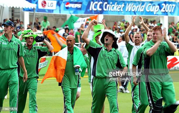 Irish cricketers and their fans celebrate their victory over Pakistan at the end of the Group D match of the ICC World Cup 2007 between Ireland and...