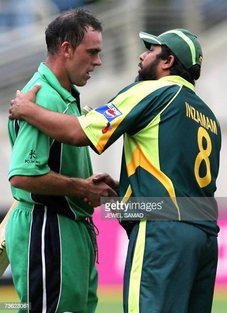 Pakistani cricket team captain InzamamulHaq congratulates his Irish counterpart at the end of the Group D match of the ICC World Cup 2007 between...