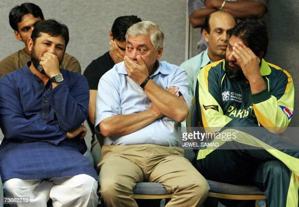 Pakistani cricketer InzamamulHaq team manager Talat Ali and acting coach Mostaq Ahman react during a memorial service for their late coach Bob...