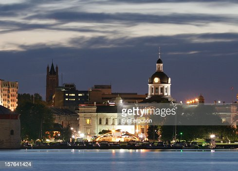 Kingston waterfront at night with cloudy sky over the church