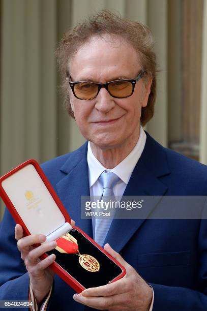 Kinks frontman Sir Ray Davies after he knighted by the Prince of Wales in recognition for his service to the arts during an investiture ceremony at...