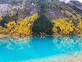 View on beautiful Kinney Lake in Canada. The blue / turquoise water runs down from the glaciers of Mount Robson.