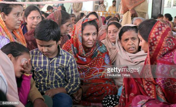Kins of deceased dera followers lamenting over their death at Dera Sacha Sauda Naam Charcha Ghar at Village Jagera on February 262017 in Ludhiana...