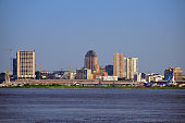 Kinshasa, Democratic Republic of the Congo: business district skyline and the Congo river - sky with copy space - photo by M.Torres