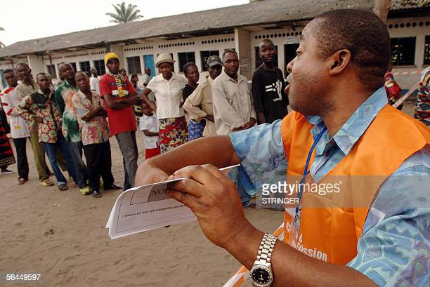 Kinshasa Democratic Republic of the Congo An election official explains to a queue of voters how to mark their vote on a ballot paper 18 December...