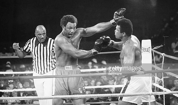 Heavyweight champ George Foreman throws a left to the eye of the Muhammed Ali during their title bout this shot twisted Ali's face but not his...