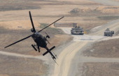 Kiowa Warrior helicopter hover during the United States and South Korean Joint live fire Exercise at Rodriguez Range on April 11 2014 in Pocheon...