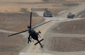 Kiowa Warrior helicopter hovers during the United States and South Korean Joint live fire Exercise at Rodriguez Range on April 11 2014 in Pocheon...