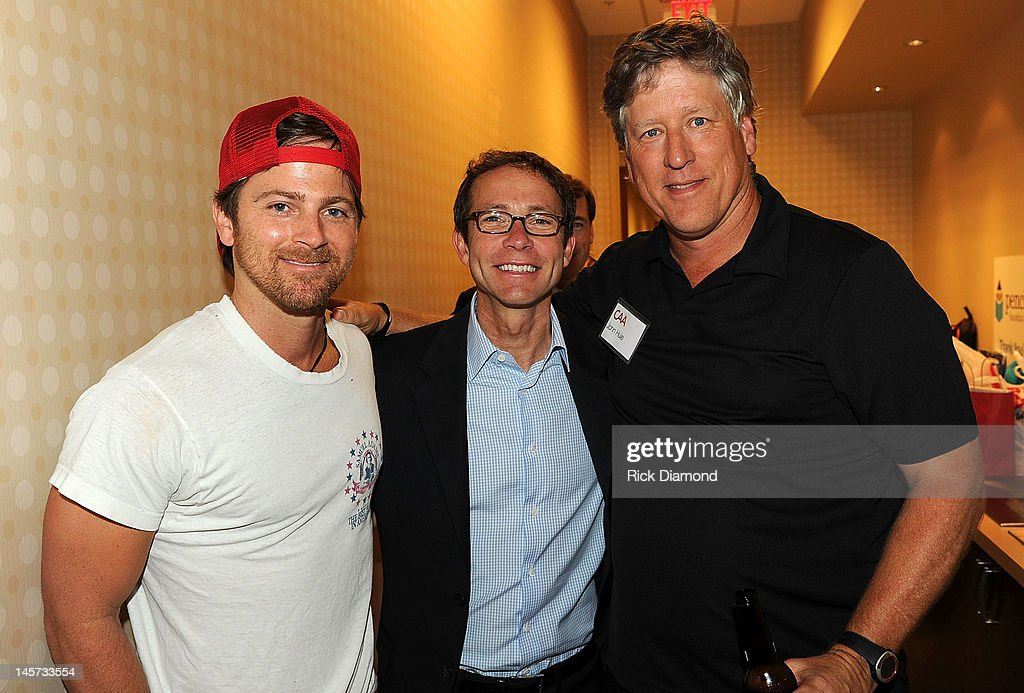 Kip Moore, CAA President <a gi-track='captionPersonalityLinkClicked' href=/galleries/search?phrase=Richard+Lovett&family=editorial&specificpeople=2094288 ng-click='$event.stopPropagation()'>Richard Lovett</a>, and CAA's John Hue attend the 20th Annual CAA BBQ at the new CAA Nashville offices on June 4, 2012 in Nashville, Tennessee.