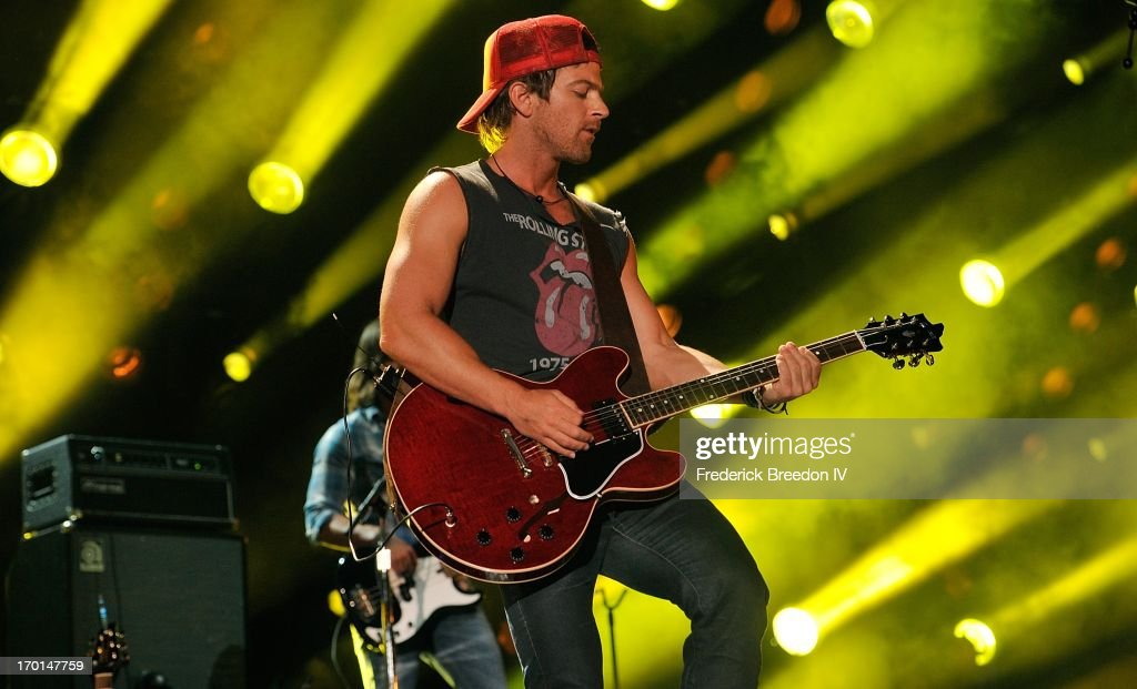 <a gi-track='captionPersonalityLinkClicked' href=/galleries/search?phrase=Kip+Moore&family=editorial&specificpeople=8375431 ng-click='$event.stopPropagation()'>Kip Moore</a> performs at LP Field during the 2013 CMA Music Festival on June 7, 2013 in Nashville, Tennessee.