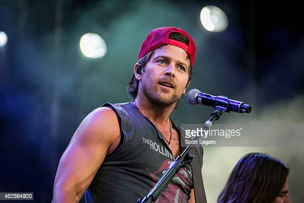 Kip Moore performs during the Faster Horses Music Festival at Michigan International Speedway on July 18 2014 in Brooklyn Michigan