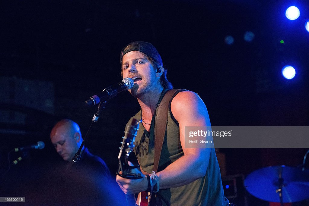 <a gi-track='captionPersonalityLinkClicked' href=/galleries/search?phrase=Kip+Moore&family=editorial&specificpeople=8375431 ng-click='$event.stopPropagation()'>Kip Moore</a> plays the 2014 Country Weekly Kick-Off Party at Mercy Lounge on June 3, 2014 in Nashville, Tennessee.
