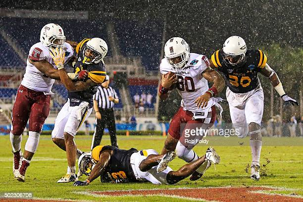Kip Patton of the Temple Owls rushes for a touchdown during the fourth quarter of the game against the Toledo Rockets at FAU Stadium on December 22...