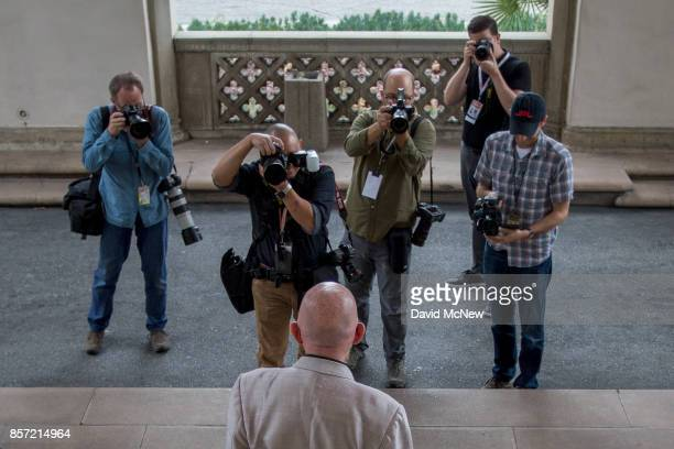 Kip Thorne poses for a group of photographers after receiving the 2017 Nobel Prize in Physics with Barry Barish at California Institute of Technology...