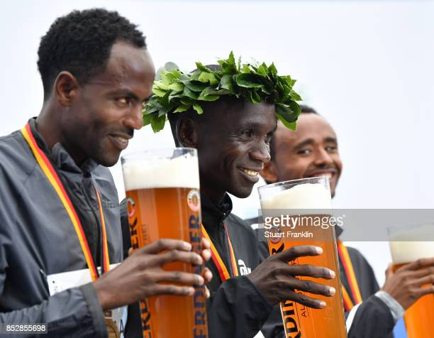 Kipchoge Eluid of Kenia celebrates with Mosinet of Ethiopia and Adola Guye of Ethiopia after winning the Berlin marathon on September 24 2017 in...