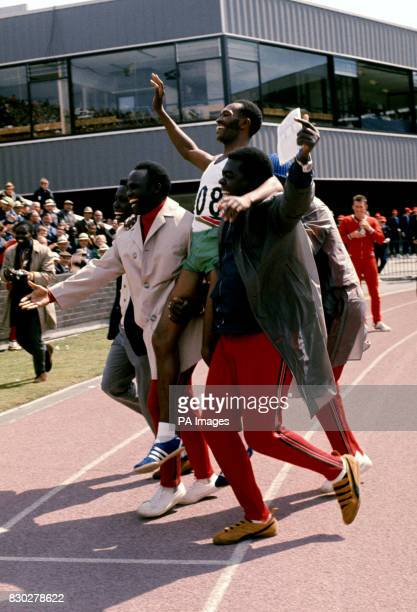 Kipchoge Keino of Kenya is swept off his feet by teammates after his victory in the 1500 metres race during the Commonwealth Games at Meadowbank...