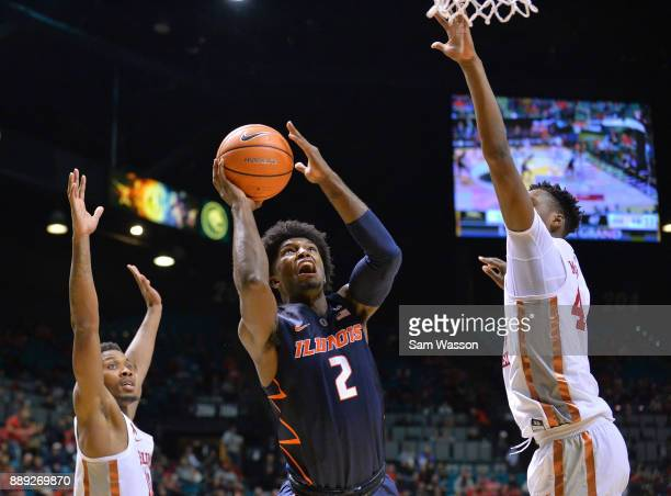 Kipper Nichols of the Illinois Fighting Illini shoots against Shakur Juiston and Brandon McCoy of the UNLV Rebels during their game at the MGM Grand...