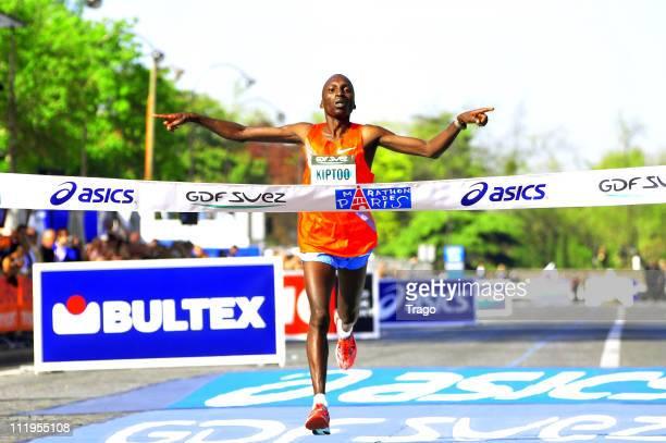 Kiptoo Benjamin of Kenya crosses the finish line to win the 35th Paris Marathon on April 10 2011 in Paris France