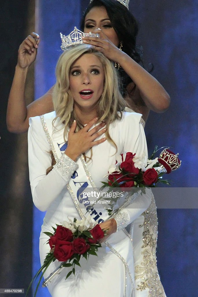<a gi-track='captionPersonalityLinkClicked' href=/galleries/search?phrase=Kira+Kazantsev&family=editorial&specificpeople=12505447 ng-click='$event.stopPropagation()'>Kira Kazantsev</a>, being crowned Miss America 2015 by <a gi-track='captionPersonalityLinkClicked' href=/galleries/search?phrase=Nina+Davuluri&family=editorial&specificpeople=11331921 ng-click='$event.stopPropagation()'>Nina Davuluri</a>, Miss America 2014 at Atlantic City Boardwalk Hall on September 14, 2014 in Atlantic City, New Jersey.
