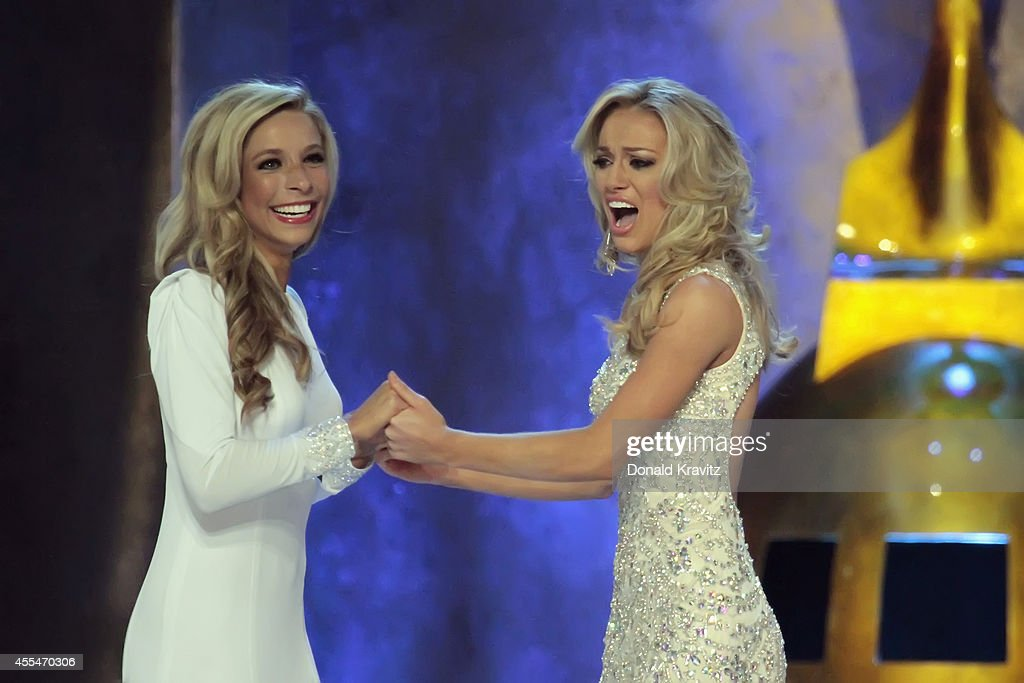 <a gi-track='captionPersonalityLinkClicked' href=/galleries/search?phrase=Kira+Kazantsev&family=editorial&specificpeople=12505447 ng-click='$event.stopPropagation()'>Kira Kazantsev</a> Miss New York and Courtney Paige Garrett, Miss Virginia wait to hear who is new Miss America 2015 at Atlantic City Boardwalk Hall on September 14, 2014 in Atlantic City, New Jersey.