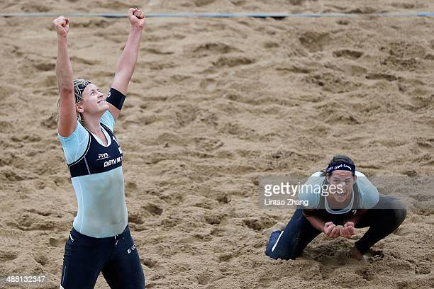 Kira Walkenhorst and Laura Ludwig of Germany celebrate beating Fan Wang and Yuan Yue of China during the Women's Final match of 2014 FIVB Shanghai...
