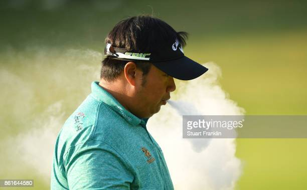 Kiradech Aphibarnrat of Malaysia smokes during the final round of The Italian Open at Golf Club Milano Parco Reale di Monza on October 15 2017 in...