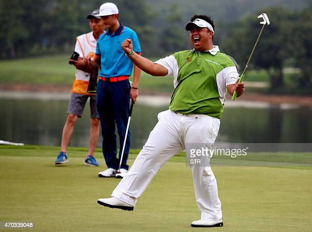 Kiradech Aphibarnrat of Thailand celebrates after beating Li Haotong of China on the playoff hole to win the Shenzhen International golf tournament...