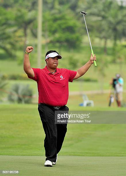 Kiradech Aphibarnrat of Thailand celebrates after he sinked a birdie on the 18th hole during thee second day's foursome matches at Glenmarie GCC on...