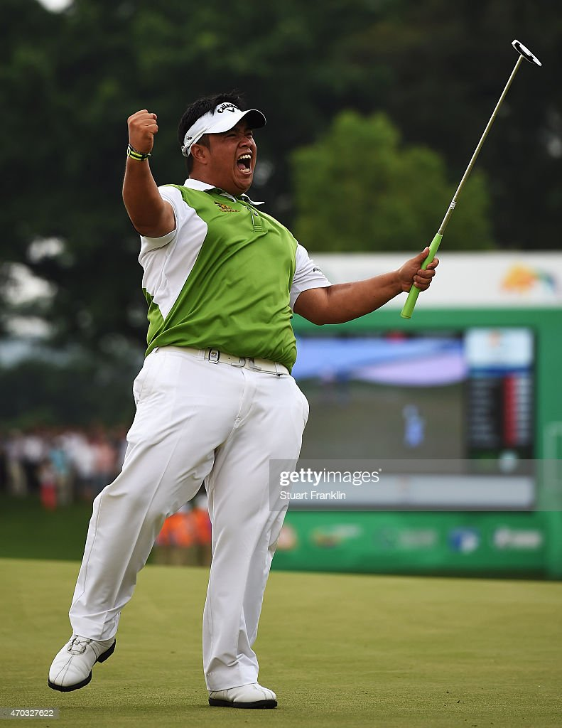 <a gi-track='captionPersonalityLinkClicked' href=/galleries/search?phrase=Kiradech+Aphibarnrat&family=editorial&specificpeople=6827713 ng-click='$event.stopPropagation()'>Kiradech Aphibarnrat</a> of Thailand celebrates his winning putt during the play off against Li Hao Tong of China afterthe final round of the Shenzhen International at Genzon Golf Club on April 19, 2015 in Shenzhen, China.