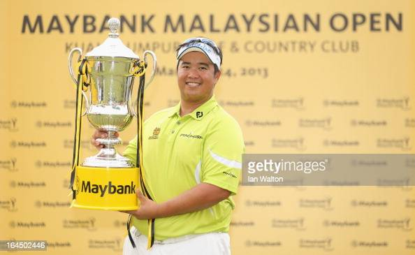 Kiradech Aphibarnrat of Thailand celebrates with the trophy after winning the 3rd and final round of the Maybank Malaysian Open at Kuala Lumpur Golf...