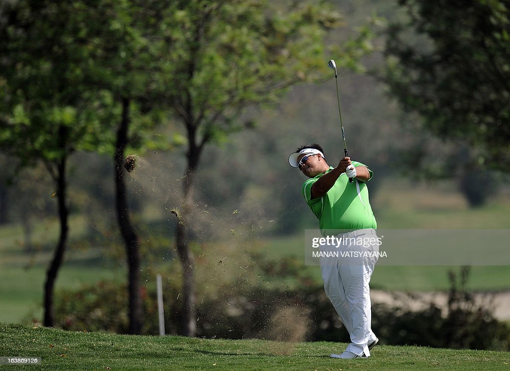 Kiradech Aphibarnrat of Thailand drives the ball on the first greens during the final day of the Avantha Masters golf tournament in Greater Noida, on the outskirts of New Delhi on March 17, 2013.