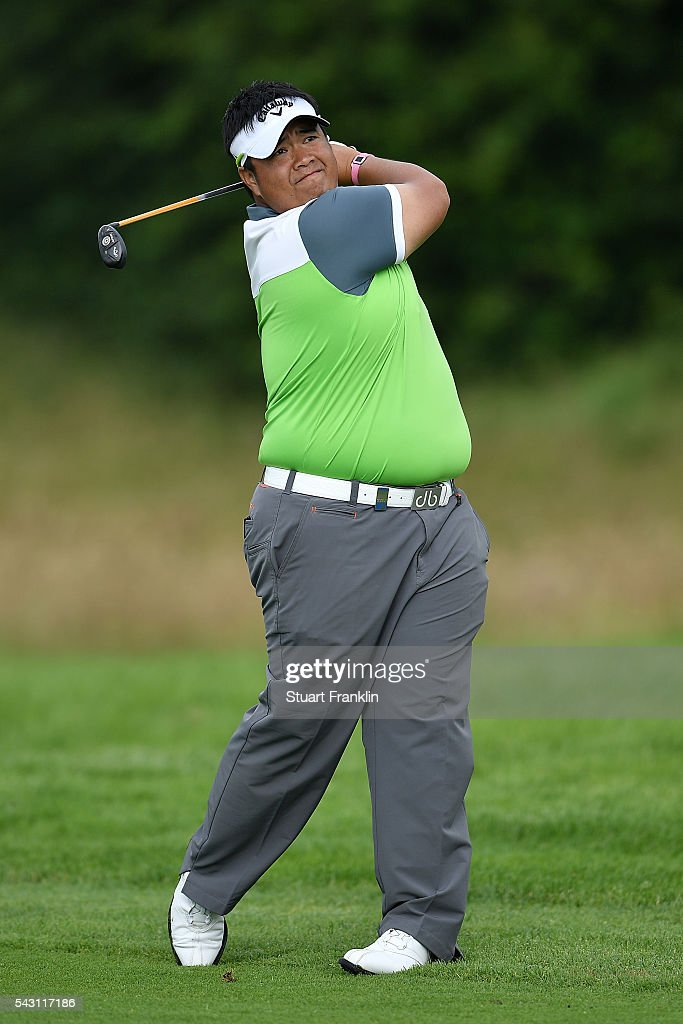 Kiradech Aphibarnrat of Thailand hits an approach during the rain delayed third round of the BMW International Open at Gut Larchenhof on June 26, 2016 in Cologne, Germany.