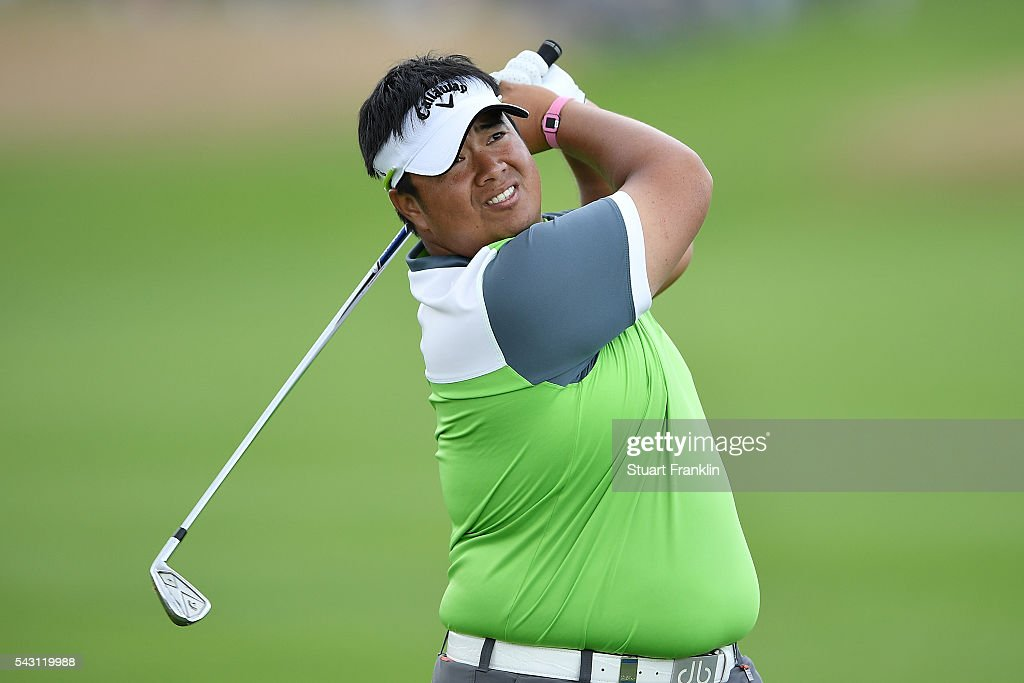 <a gi-track='captionPersonalityLinkClicked' href=/galleries/search?phrase=Kiradech+Aphibarnrat&family=editorial&specificpeople=6827713 ng-click='$event.stopPropagation()'>Kiradech Aphibarnrat</a> of Thailand hits an approach during the rain delayed third round of the BMW International Open at Gut Larchenhof on June 26, 2016 in Cologne, Germany.