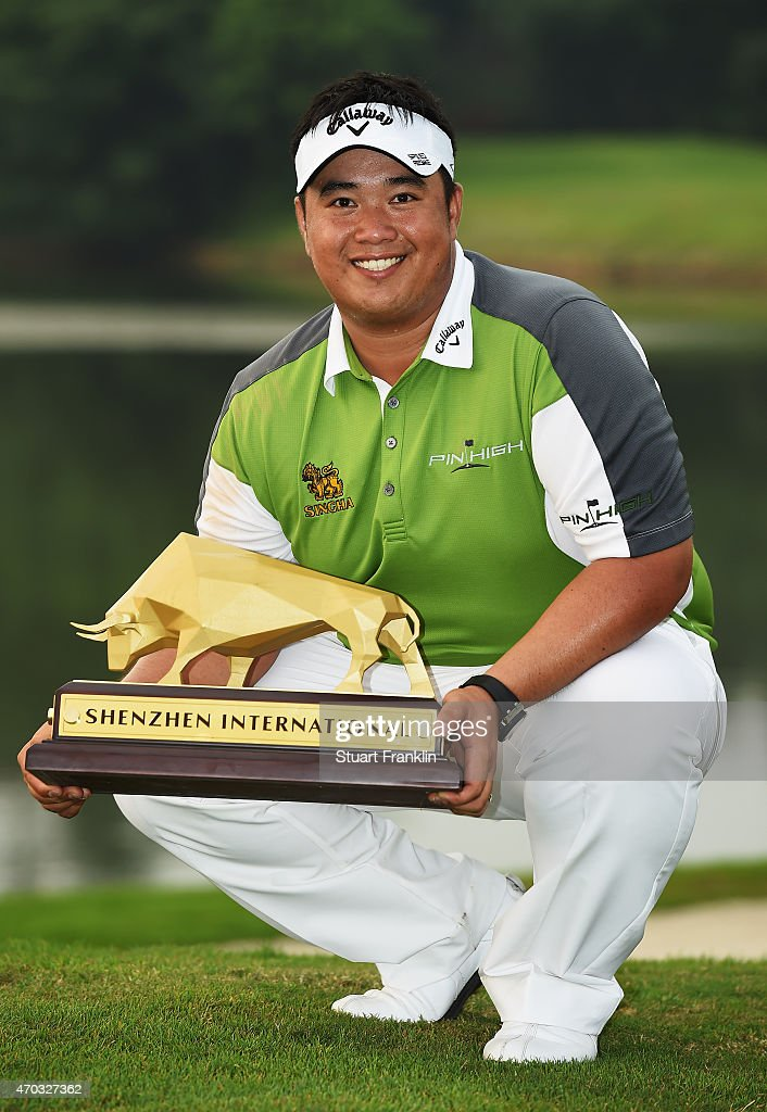 <a gi-track='captionPersonalityLinkClicked' href=/galleries/search?phrase=Kiradech+Aphibarnrat&family=editorial&specificpeople=6827713 ng-click='$event.stopPropagation()'>Kiradech Aphibarnrat</a> of Thailand holds the trophy after winning the Shenzhen International at Genzon Golf Club on April 19, 2015 in Shenzhen, China.