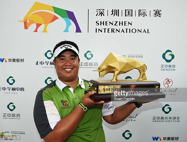 Kiradech Aphibarnrat of Thailand holds the trophy after winning the Shenzhen International at Genzon Golf Club on April 19 2015 in Shenzhen China